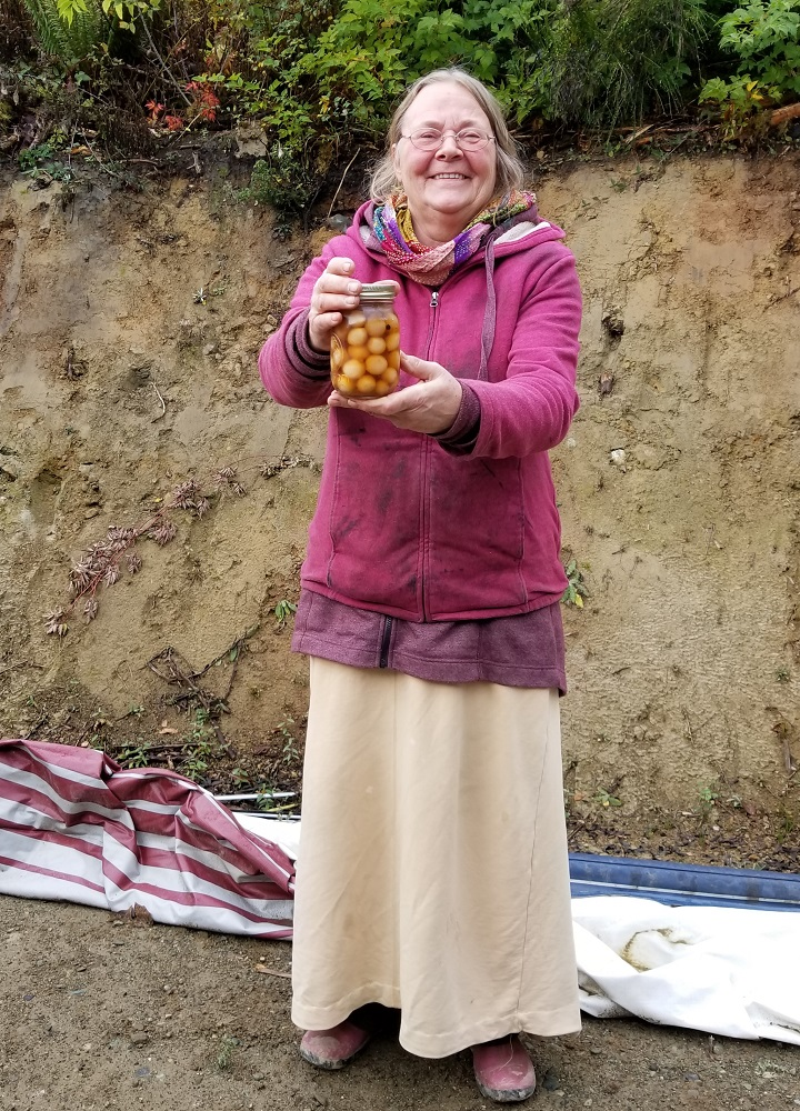 Joan passing her pickled onions