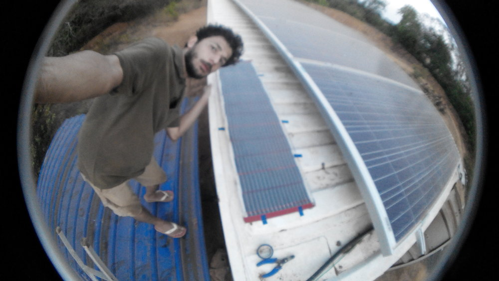 A selfie I took after ALL the panels were succesfully installed and data collection would start soon. All the solar cells on the roof of the electrical substation hut. In the middle is the OPV, to the right are regular crystalline Silicon and higher up are amorphous silicon. Outside the picture is CIGS solar cells.