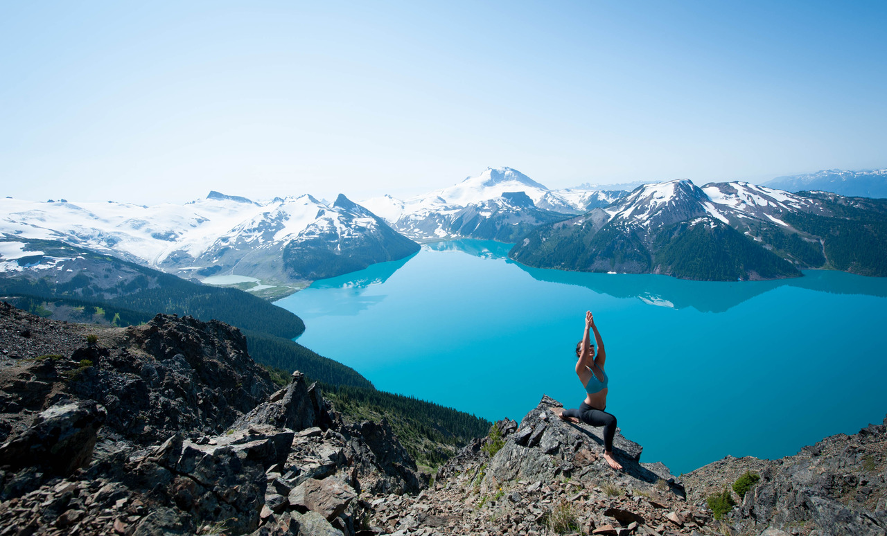 Virabhadrasana on top of Panorama Ridge, Garibaldi Provincial Park.