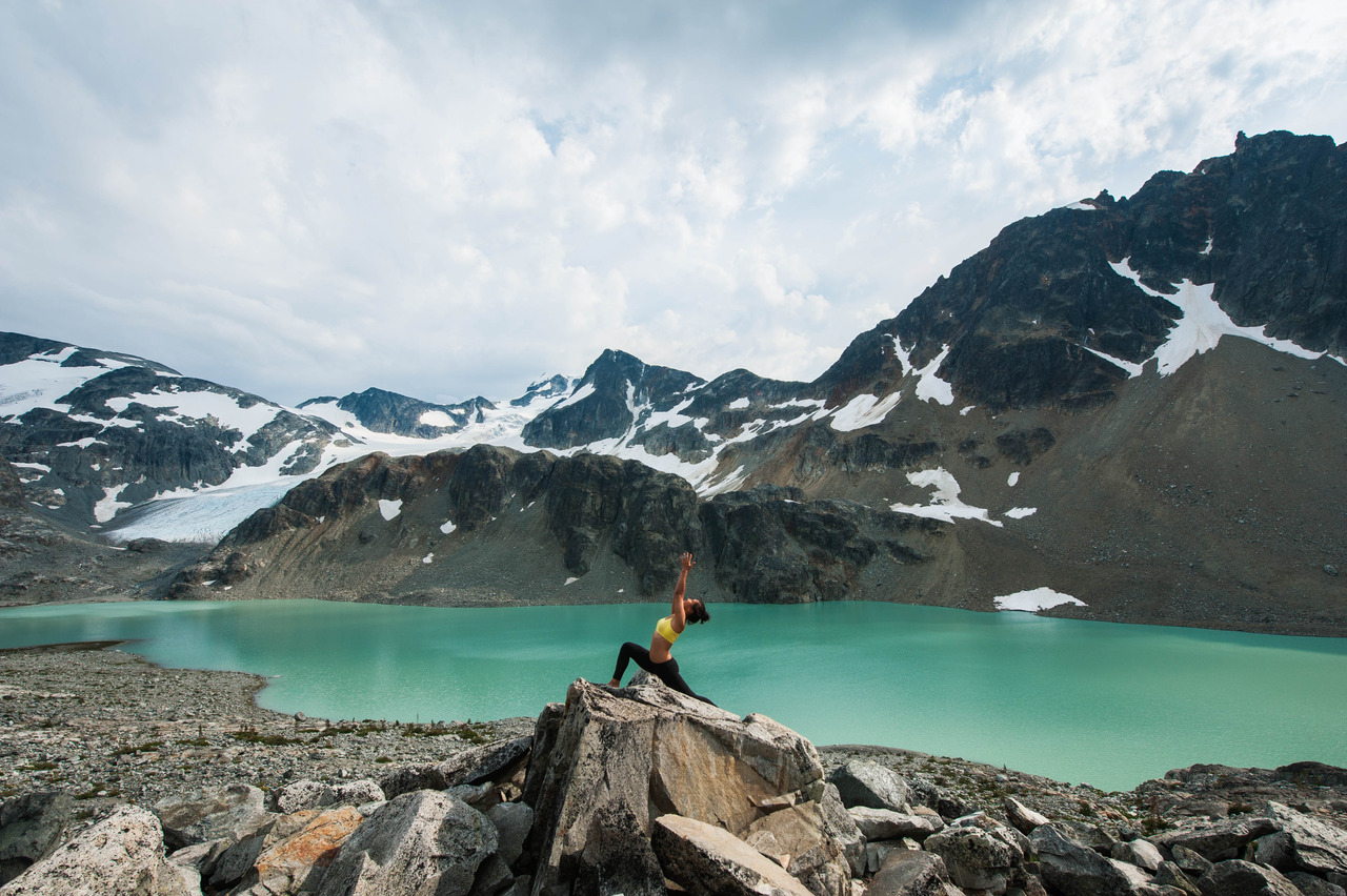 Virabhadrasana at the stunning glacier-fed Wedgemount Lake  Virabhadrasana A | Warrior A  Wedgemount Lake | Garibaldi Provincial Park | Whistler | British Columbia | Canada
