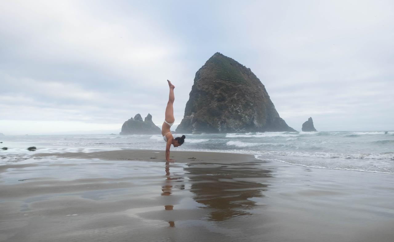 Live in the sunshine.  Swim in the sea. Drink the wild air.    -Ralph Waldo Emerson          Adho Mukha Vrkasana | Handstand  Cannon Beach | Oregon | USA