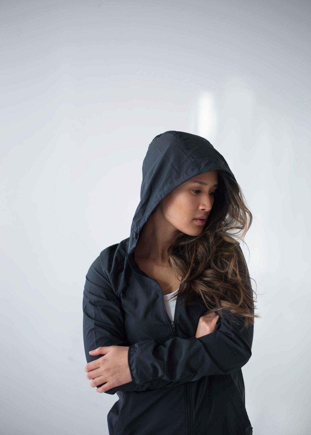 Wearing:   Nike Women's Essential Hooded Running Jacket  from  Sport Chek