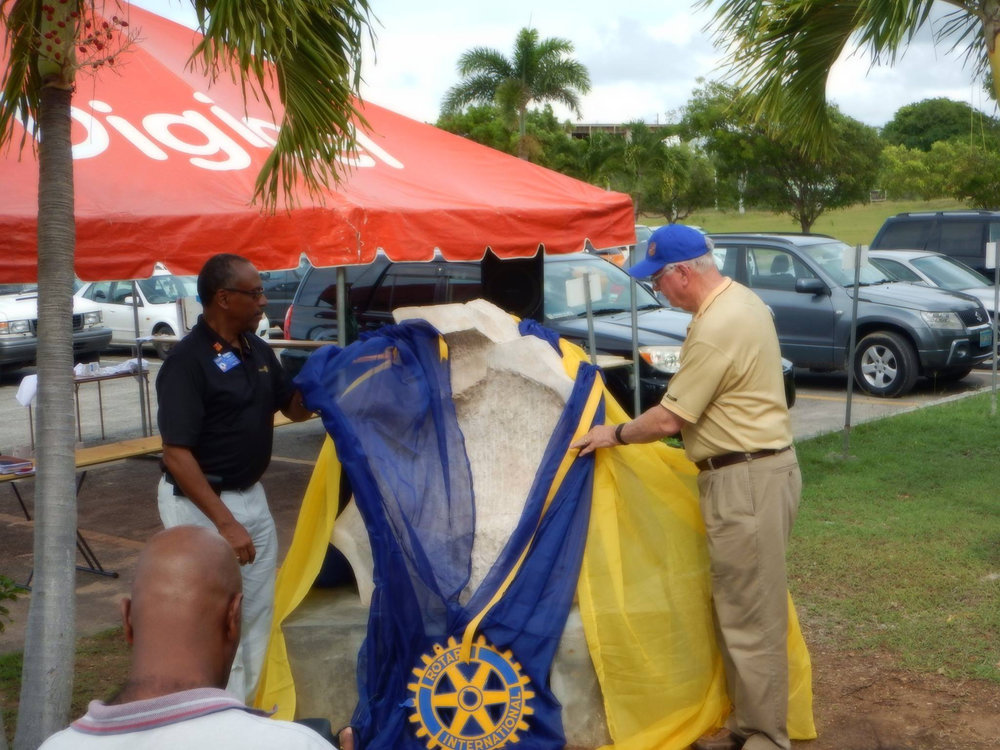 Ian Riseley, President-Elect of Rotary International (Rotary Club of Sandringham, Victoria, Australia) and Robert Leger, District Governor Elect of Rotary District 7020 (Rotary Club of Les Cayes) unveil 'End Polio Now' at Clayton J. Lloyd International Airport. photo by Jacquie Ruan