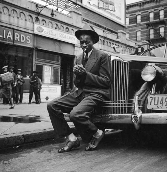 Baseball player Satchel Paige outside poolroom in Harlem, 1941