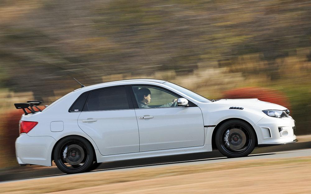 2012-Subaru-Impreza-WRX-STI-S206-side-in-motion.jpg