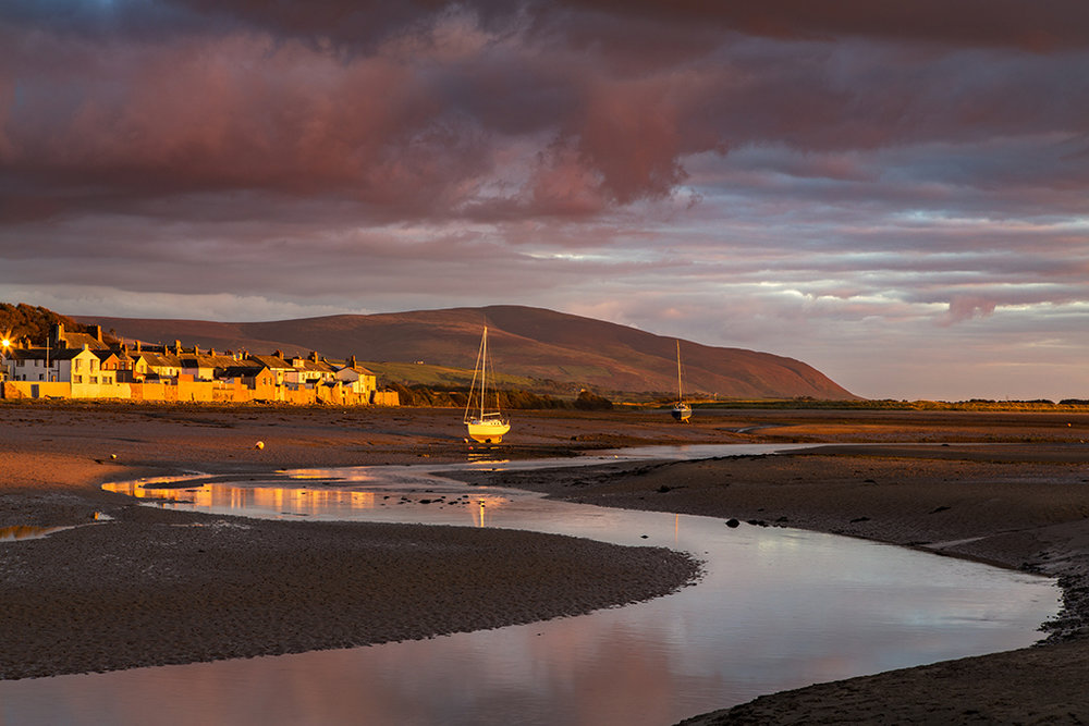 Black Combe overlooks Ravenglass as a Firey sunset descends.jpg