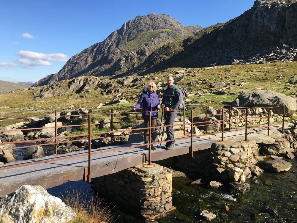 Irene and Rob with Tryfan magnificent in the background. The wind was near to gale force with winds reaching 54mph. There are times I am glad I am bald.....
