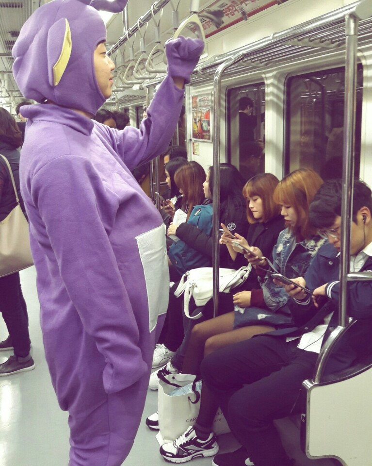 Elton (left) wears a teletubbies costume on his way to Itaewon on Halloween.