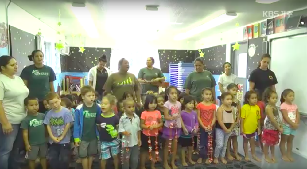 Preschool students from Pūnana Leo o Hilo sing a song in Hawaiian for their Korean visitors.