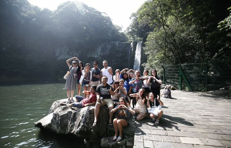 Summer and friends pose in front of  Cheonjiyeon Falls on Jeju Island in South Korea.