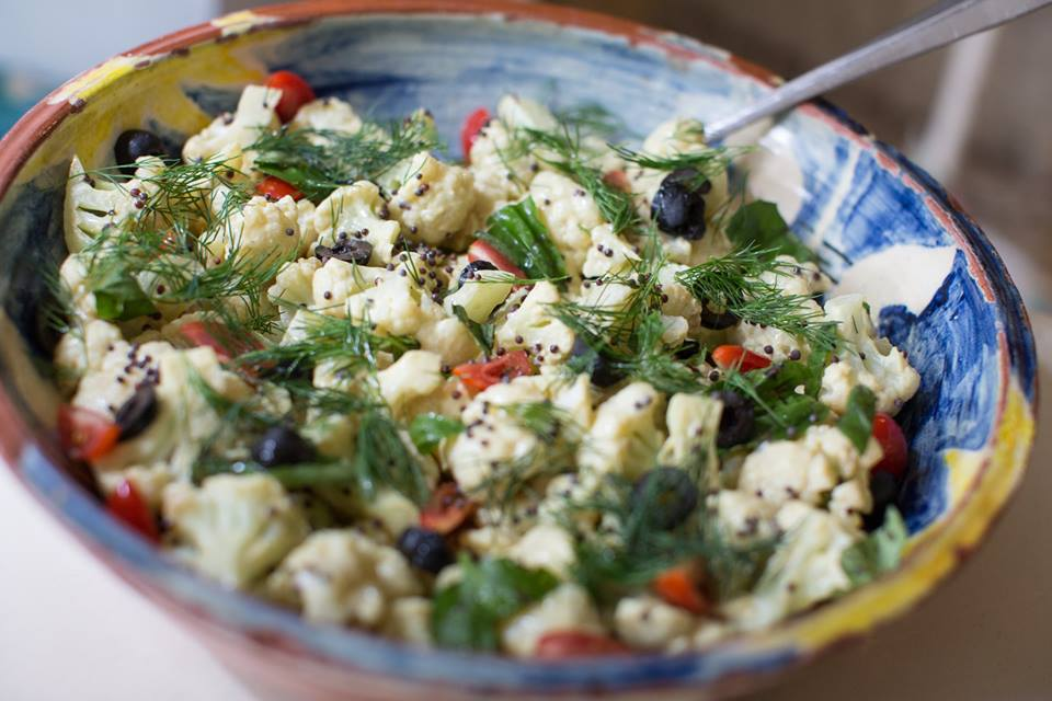 Cauliflower and olive salad, with mustard seeds and dill