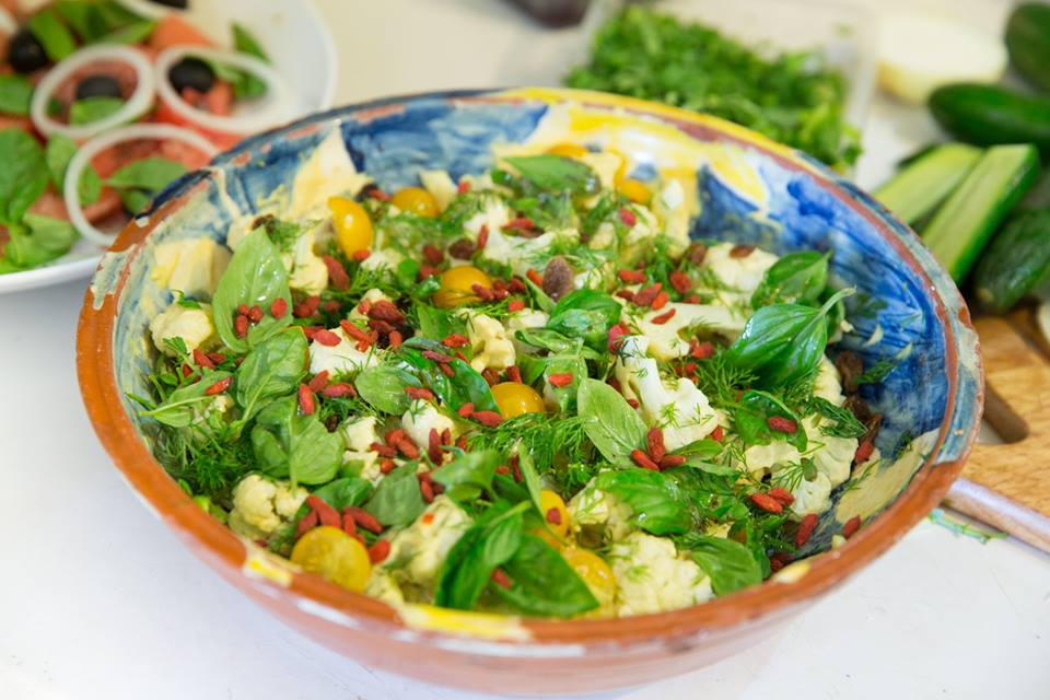 Cauliflower and cherry tomatoes with fresh basil, raisins, dill and goji berries. We're overflowing with super-foods. Eat well
