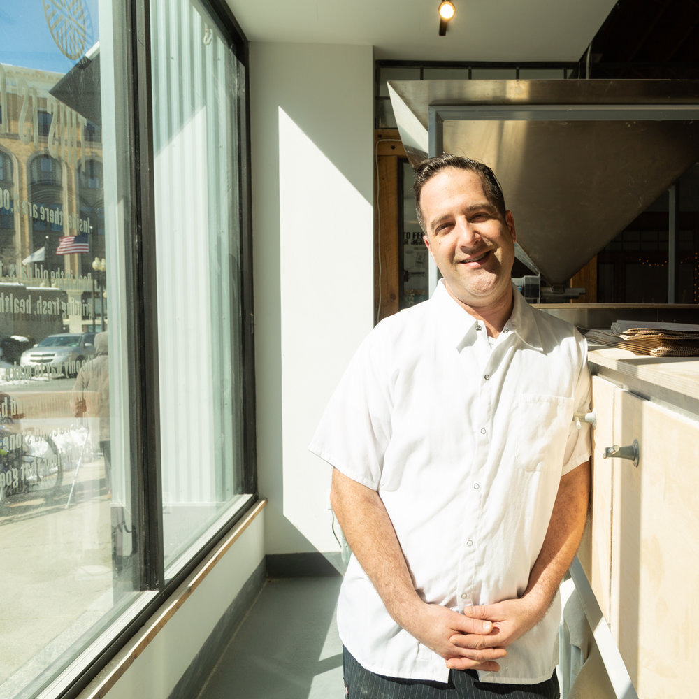 Co-Founder and Head Baker Tony Rosenfeld - the Mill looks out on Exchange Street in downtown Lynn