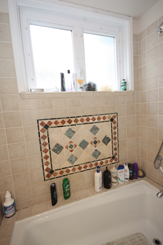 Full Bath: Lower Unit: View of the tiled shower surround in the lower unit's full bathroom.
