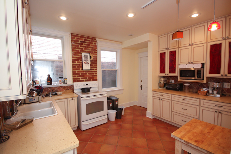 Kitchen: Lower Unit: Kitchen has been fully renovated with quartz countertops, upgraded cabinets, tile floors and more.