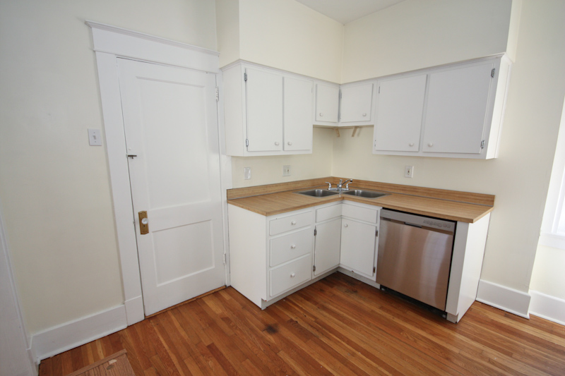 Kitchen: Upper Unit: There is plenty of storage in the kitchen. There is private access to the basement.