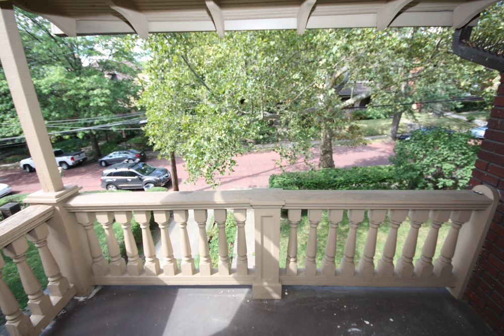 Patio/Deck: Upper Unit: View of the balcony at the upper unit facing the front yard.