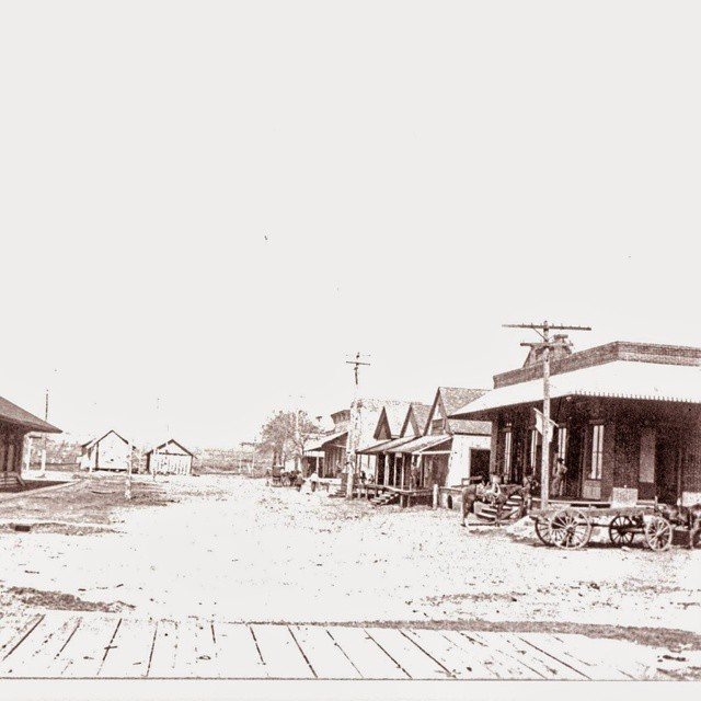 Railroad St in Burton, Texas early 1900's. From our collection at Burton Railroad Depot &Museum. Depot is on left, Fisher store on the right