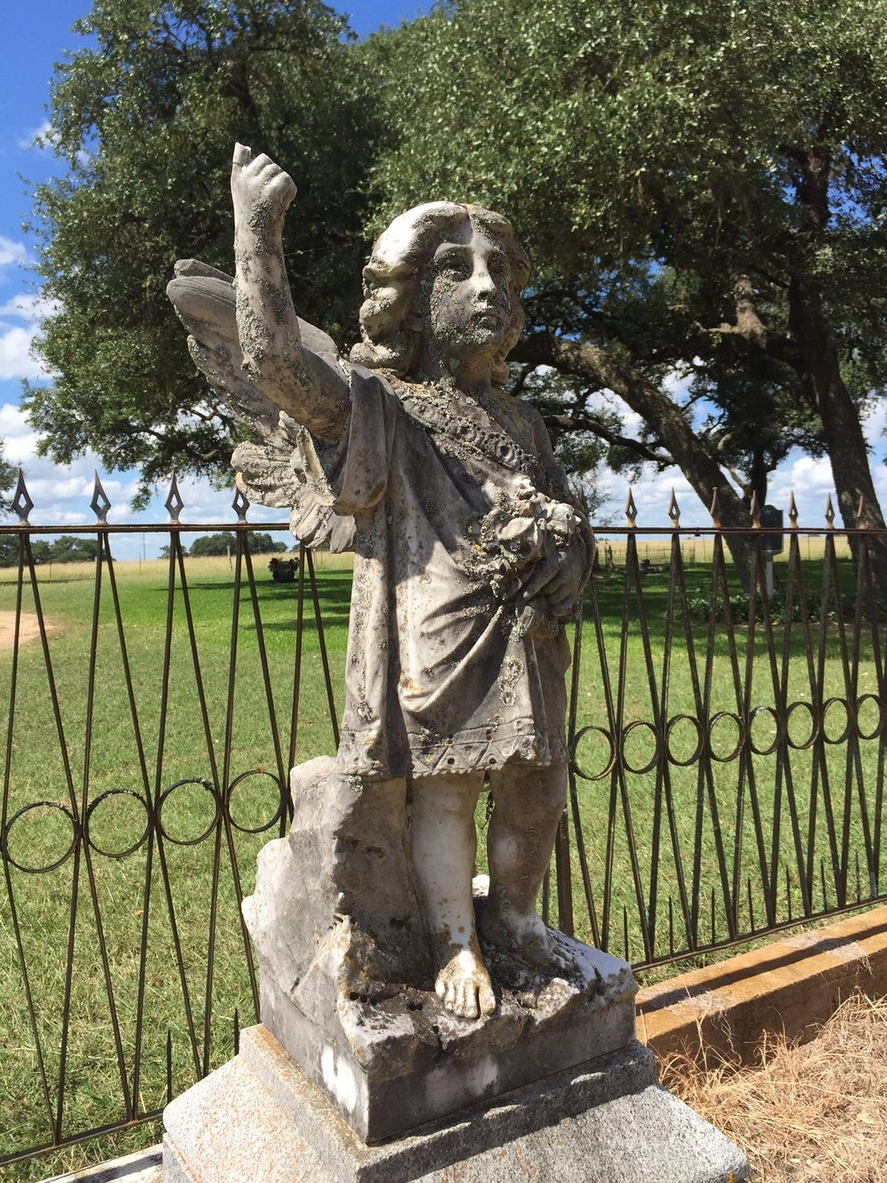 A beautiful angel monument greets visitors near the front of the cemetery
