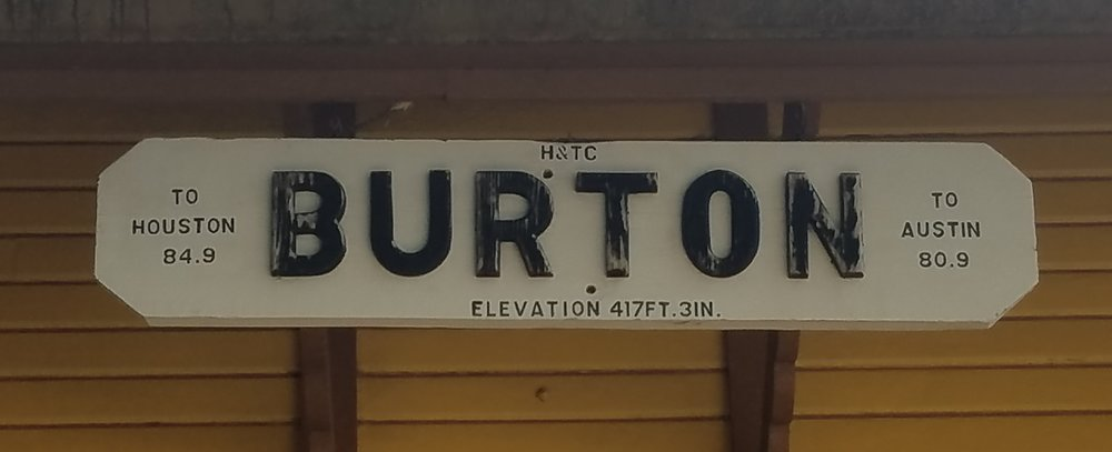 Burton marker listing elevation and distances to Houston & Austin