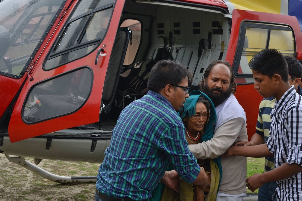The CYF Collective's first helicopter rescue mission transported Furke Lama, age 55, from Dhap, Sindhupalchowk to the Dhulikhel Hospital. Her multiple injuries included a rib bone fracture, deep forearm wound, possible sepsis, and a severe chest infection. This rescue mission, led by Dr. Sajal Shakya, Dr. Roshan Piya, and Prajwan Shrestha, also airlifted two others to the hospital. During the same trip, they dropped 350 kilos of relief items to Gunsa, Sindhupalchowk as well. This helicopter trip was funded by our friend Marie Claire in France.