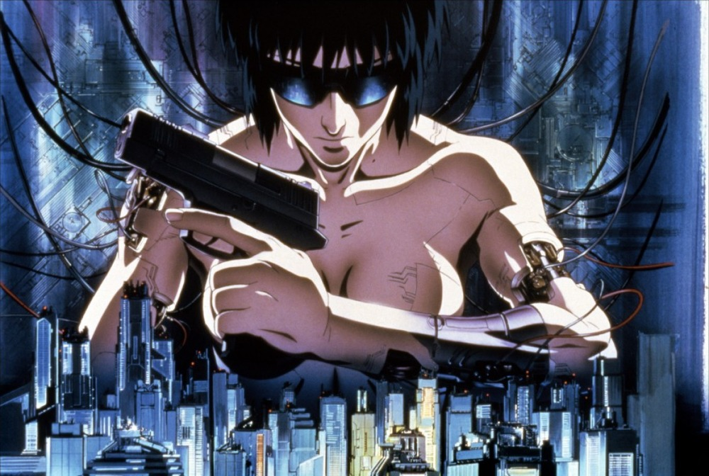 "Ghost In The Shell- (film-1995)  I can't even tell you guys how many times I've seen this film. Though I haven't watched it much in recent years, ghost in the shell remains at the forefront of my mind whenever asked or just talking about anime in general. Aside from the step up in quality of art and rendering of the 80's into early 90's, ghost in the shell has one of the best intro sequences I've ever seen on film. In the near technological dystopian future where almost every human is a now a cyborg or extensively enhanced-The story follows Maj. Motoko Kusanagi as she and her small band of enhanced federal agents hunt down the notorious ""Puppet Master"", an international terrorist hacking into the minds of cyborgs and enhanced humans alike. Using this method, the puppet master is able to create a vast yet elusive network of terrorist.  But after a brief run in with the puppet master, Maj. Kusanagi is left pondering not only her identity and existence but also the reality in which we all exist."
