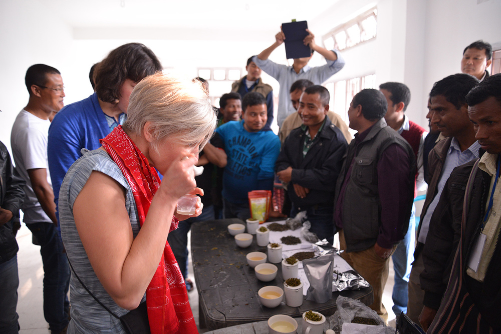 Laurie cupping tea in Assam