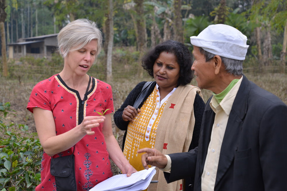 Laurie, Level Ground co-owner, and Someswar visit in his Assam tea garden.