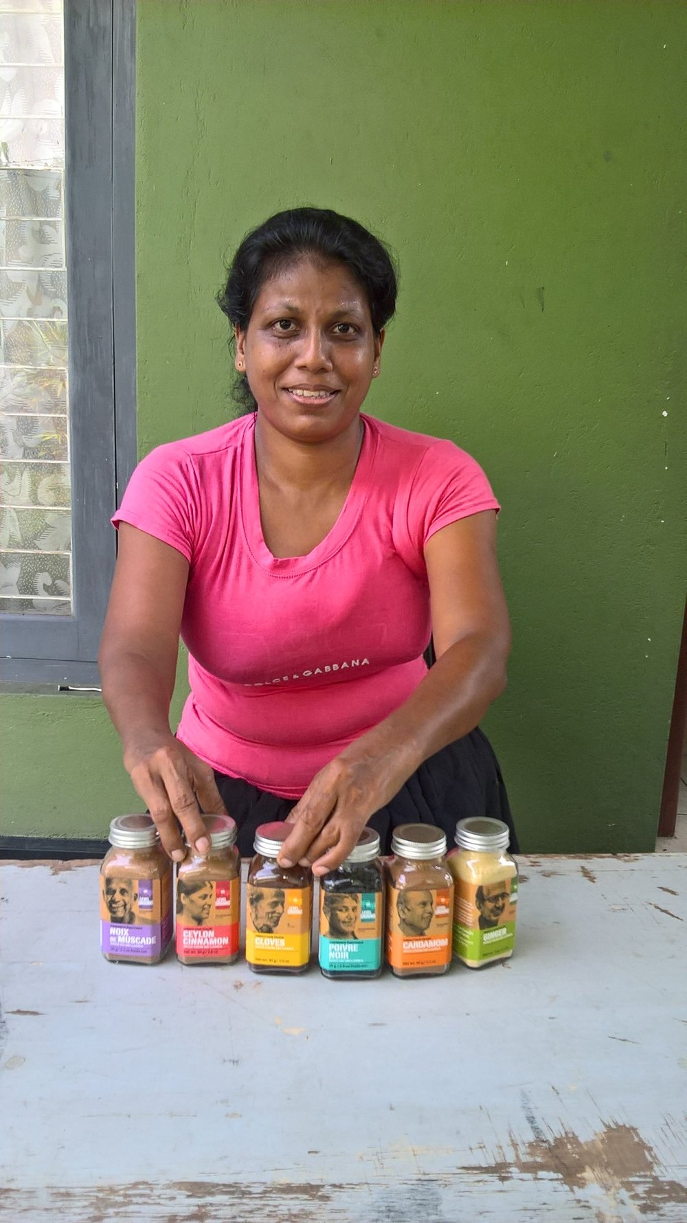 Menaka poses with freshly labelled spices.