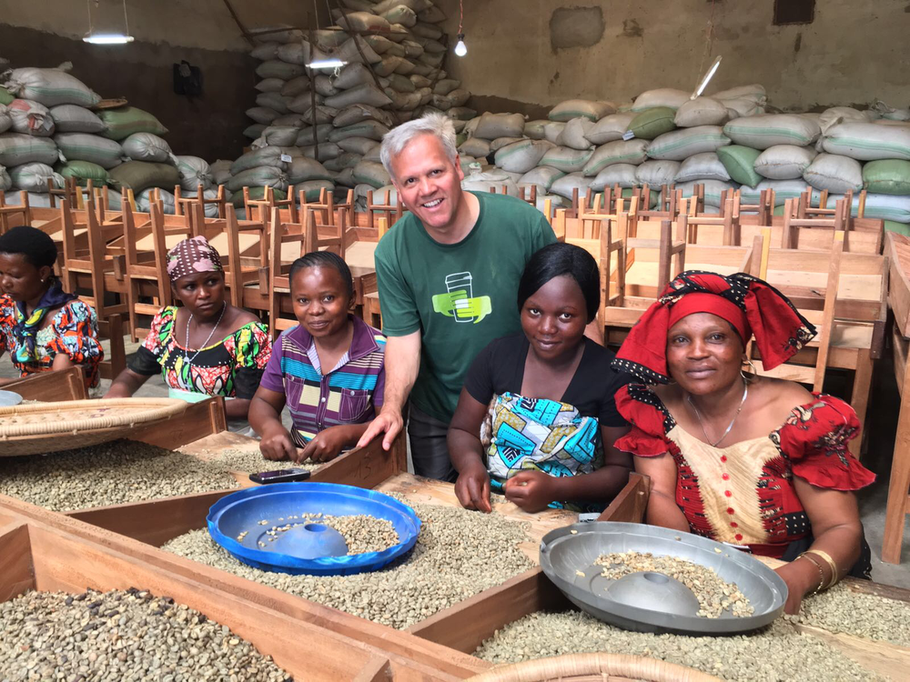 "Hugo and the ""Mamas"" - women who sort the green coffee beans."