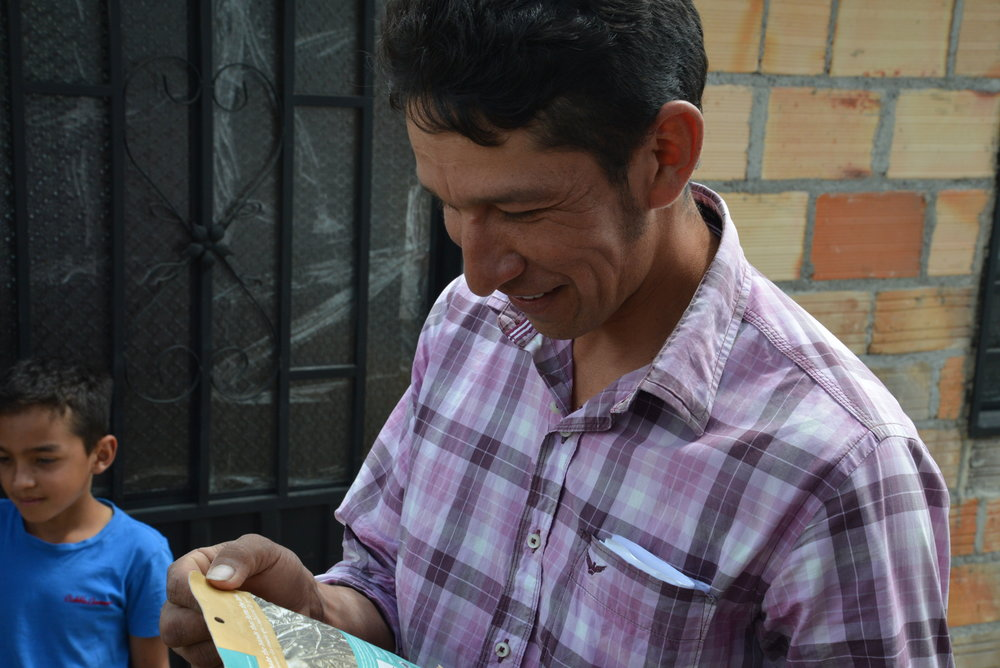 Esteban, one of the farmers, sees himself of the back of the new package for the first time.