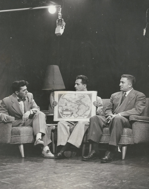 Siney B. Solomon and Henry Chafetz talking about maps.  c. 1955