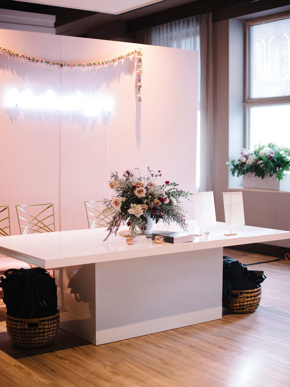 Photography by: Sarah Vaughan / Desk Florals by: Always Sunny Design / Window Florals by: Fleurish / Table by: Modern Luxe Rentals / Signage by: Art + Alexander / Venue: The Hudson