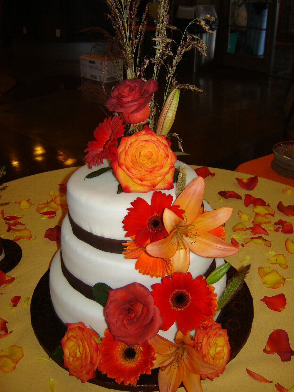 Waldorf Astoria cake decorated with fondant and fresh flowers.