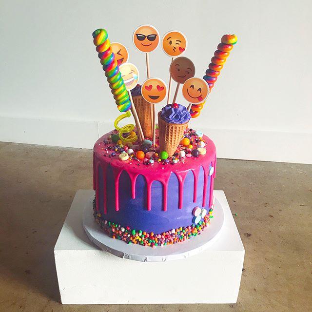 Emoji themed Cake 😍😎😇🤩 .. vanilla cake with purple buttercream & a pink chocolate ganache drip. I love the NERDS border 😋🍭🍬