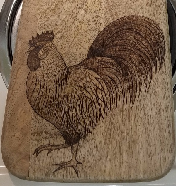 Rooster on a cutting board