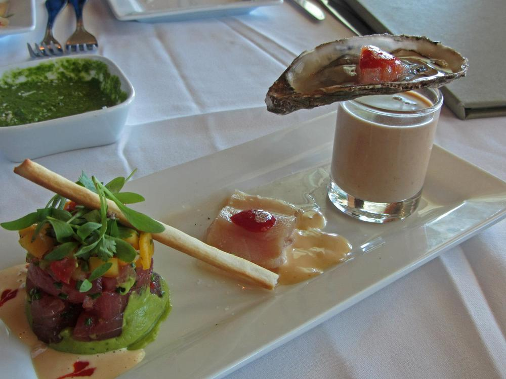 Ahi with mango salsa, avocado, wasabi aioli; hamachi sashimi with jalapeno pepper jam and limoncello vinegar; Lobster bisque with porcini infusion topped with a Malpeque oyster and sriracha granita;