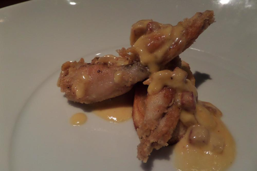 Crispy frog legs with Japanese prawns, Spanish chorizo, and sauvignon blanc buerre blanc.