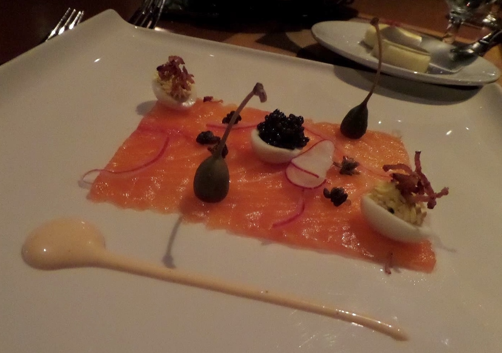 Citrus vodka-sake cured salmon with caper berries, radish, and deviled eggs with bacon and Osetra caviar.