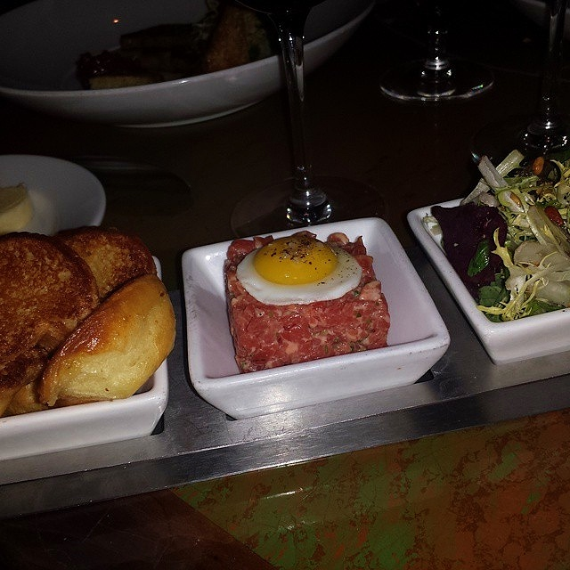 Steak tartare with black truffle aioli and quail egg with brioche.