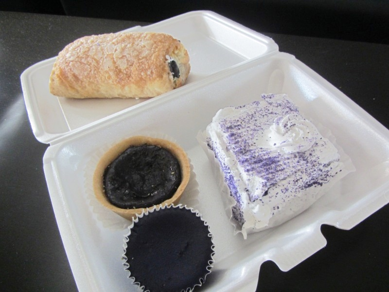 Purple yam (ube) desserts including ube and cheese stuffed pastry, tart, cheesecake, and mousse torte.