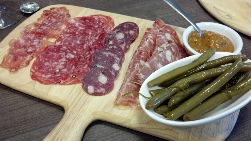 "Olli Norcino salami, Salchichon De Vic Catalonian salami, Angel's duck salami, Smoking Goose sopressata, ""Mean Beans"" and mustard."