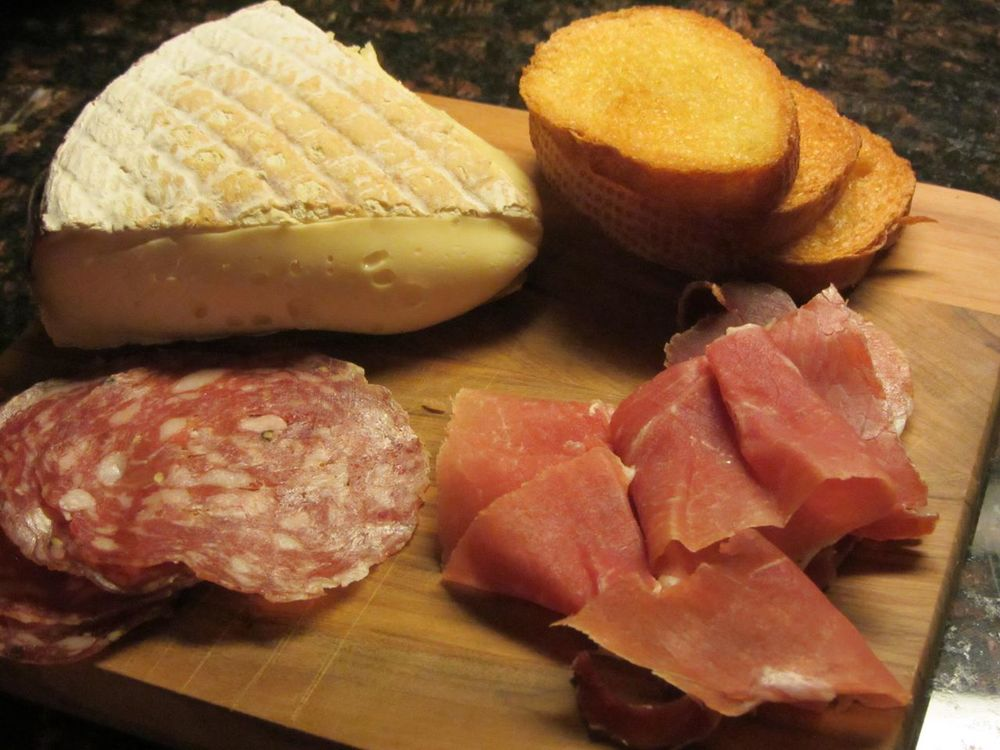Salami, prosciutto, and L'Edel de Cleron,