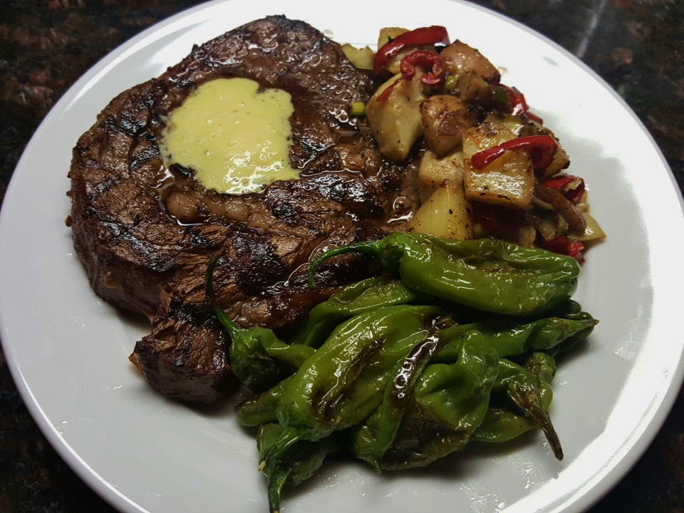 Grilled ribeye with shishito peppers and artichoke-potato hash
