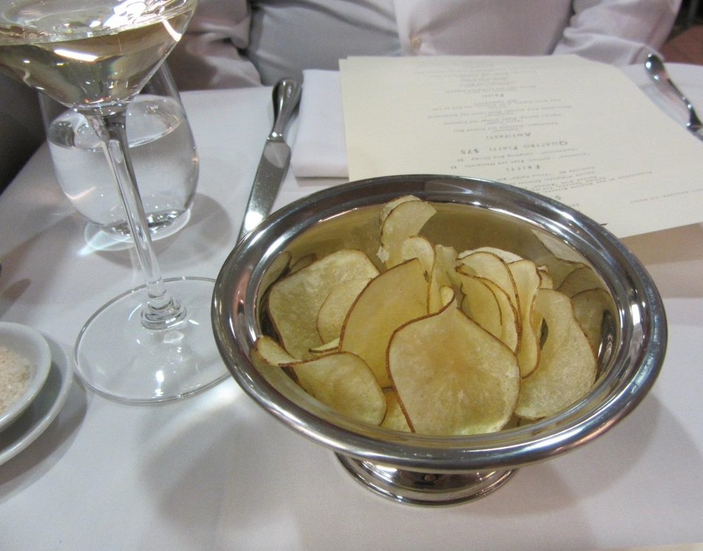 A traditional tajut of complimentary Friuli white wine and fresh chips