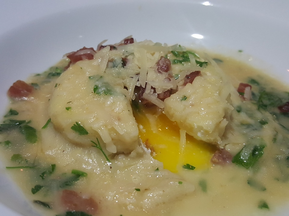 Raviolo with egg, truffle ricotta and brown butter