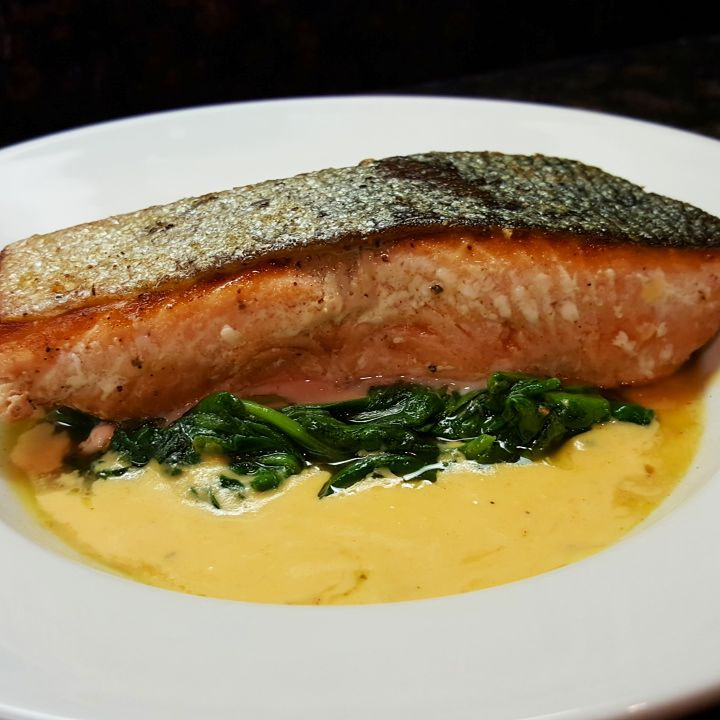 Crispy-skinned chinook with garlic spinach and shrimp bisque sauce