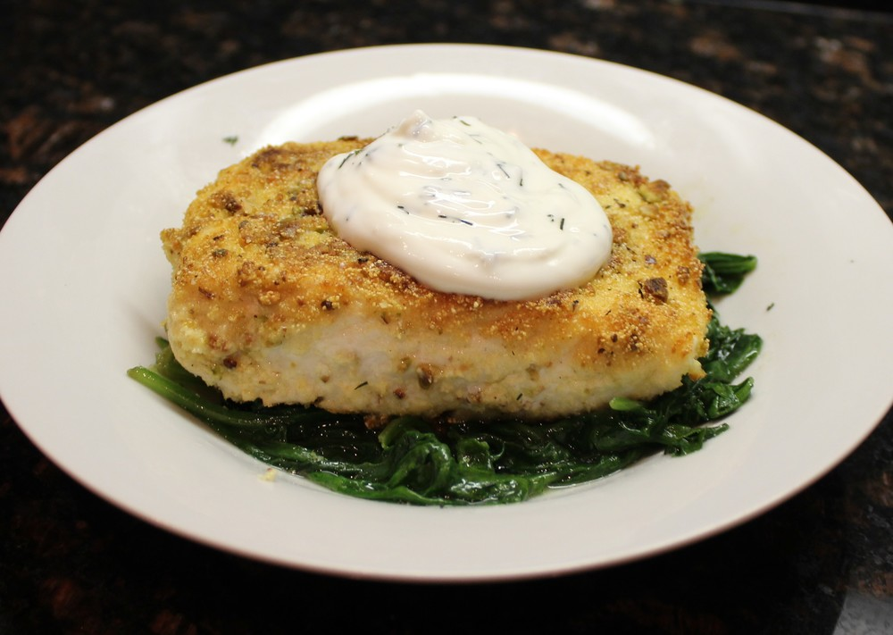 Pistachio-crusted halibut with yogurt-dill sauce and sauteed spinach
