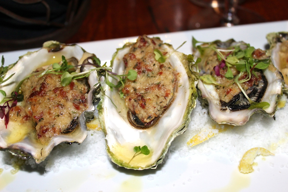 Chef Creek Oysters, bacon-horseradish-chervil butter and lemon oil.
