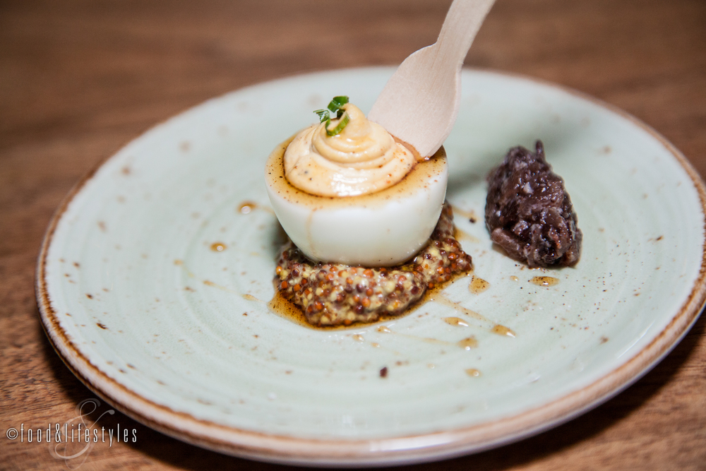 Deviled egg with pasilla-maple syrup, bacon-onion marmalade and grain mustard